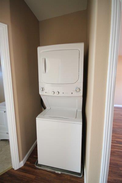 Stacked Washer And Dryer Combo In A Nook Inside The Apartment