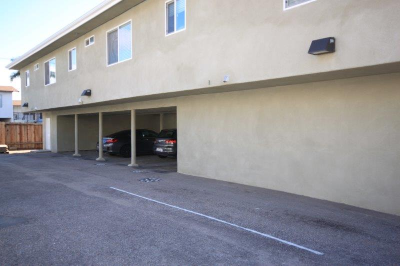View From The Parking Lot Showing 4 Carports In A Row Underneath The Upper Apartments