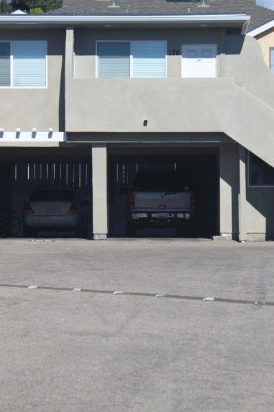 View From The Parking Lot Showing Unit 176 Front Door And Window Upstairs And Cars Parked Underneath